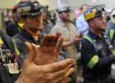 Coal miners applaud U.S. EPA Administrator Scott Pruitt as he addresses those April 13 at Harvey Mine in Sycamore, PA.