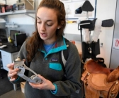 Colorado School of Mines mechanical engineering student Megan Auger holds an aluminum prosthetic dancing foot.